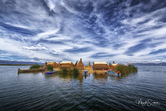 The floating islands of Titicaca (marko.erman) Tags: peru titicaca lake latinamerica southamerica highaltitude floatingislands uros indigenouspeople iconic scenic water sky clouds sun sunny village travel sony houses boats pov outdoor outside