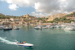 Friends (biktoras07) Tags: gozo malta vessel boat friends water sky vilage church port clouds sea mediterranean victorsantos
