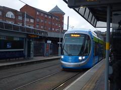 West Midlands Metro tram 32 - St Paul's Tram Stop (ell brown) Tags: birmingham westmidlands england unitedkingdom greatbritain snowhill stpaulstramstop stpaulsmetrostop westmidlandsmetro constitutionhill tree trees tram urbos3 caf rechargeablebatteries