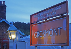 RD20891.  Station Sign. (Ron Fisher) Tags: grosmont grosmontstation station sign lamp gare bahnhof evening eveninglight rail railway railroad railwaystation sony sonyrx100iii sonyrx100m3