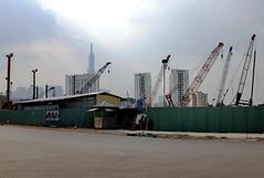 . (Out to Lunch) Tags: thu thiem district 2 new saigon ho chi minh city vietnam rapid urbanization urban suburban architecture cranes fences blue sky future