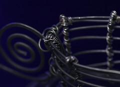 Handmade Wire Basket (j.towbin ©) Tags: allrightsreserved© macro wire craft basket wirebasket twisted curved wrapped metal spiral img4028adj handmade macromondays lowkey ef100mmf28lisusmmacro
