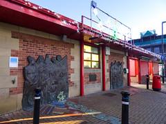 Sculpture at Chorley market, 2019 Dec 09 (Dunnock_D) Tags: britain chorley england gb lancashire uk unitedkingdom blue market paved shops sky