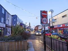"Market Street with a ""No cycling"" sign, Chorley, 2019 Dec 09 (Dunnock_D) Tags: britain chorley england gb lancashire marketstreet nocycling townhall uk unitedkingdom blue shops sign signs sky"