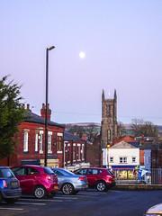 Moon, St George's church, and West Street car-park, Chorley, 2019 Dec 09 (Dunnock_D) Tags: britain chorley england gb lancashire stgeorges uk unitedkingdom blue buildings cars church lamppost parked sky