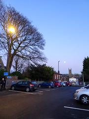 West Street car-park, Chorley, 2019 Dec 09 (Dunnock_D) Tags: britain chorley england gb lancashire stgeorges uk unitedkingdom weststreet blue buildings carpark cars church lamppost parked sky tree trees