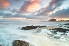 First Light at Bamburgh (captures.in.time) Tags: landscape landscapephotography northumberland england iconic le longexposure water rock ngm ngc photography seascape coastal coast beach rocks bamburgh castle sunrise northumbria canon canonphotography light