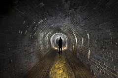 The underworld (Camera_Shy.) Tags: underground drain culvert river tunnel arch brick stone stonework old hidden below ground urban exploring urbex backlight silhouette