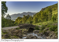 Ashness Bridge (Paul Simpson Photography) Tags: skiddaw lakedistrict cumbria mountains mountain bridge ashnessbridge england paulsimpsonphotography trees history road june2019 summer evening river stream bluesky roadside outdoorphotography nature naturephotography scenic scenicbritain uk europe rocks mountainous
