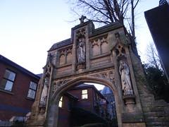 Gateway to St Mary's church, Chorley, 2019 Dec 09 (Dunnock_D) Tags: britain chorley england gb lancashire stmarys uk unitedkingdom blue church entrance gate sky statues trees