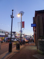 Streetlight on Market Street, Chorley, 2019 Dec 09 (Dunnock_D) Tags: britain chorley england gb lancashire marketstreet uk unitedkingdom blue lamppost shops sky streetlight