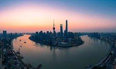 Panoramic View of the Skyline of Shanghai City at Dawn (asusmt) Tags: shanghai peoplesrepublicofchina river sky skyline skyscraper sunrise panorama city cityscape urban downtown drone aerial tower horizon landscape landmark