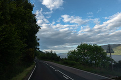 Highway Along Loch Ness (Jocey K) Tags: tripukeroupe2019 june uk scotland hills landscape sky clouds scene lake loch trees road highway sign evening lochness