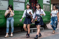 Tokyo 2019 (burnt dirt) Tags: shibuya tokyo japan asia japanese asian candid documentary street photography downtown metro urban city scramble crossing outdoor people person fujifilm xt3 fujinon 50mm f2 woman girl smile laugh train station style fashion life real crowd tourist emotion expression portrait close nippon couple girlfriends school uniform minnie mouse disney