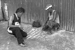 Playing games (Beegee49) Tags: street people men playing games blackandwhite monochrome panasonic bw fz1000 bacolod city philippines asia dama