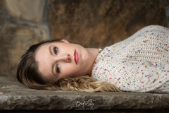 Fall Portrait (Brad Lackey) Tags: girl teen portrait youth face sweater rock stone externalflash offcameraflash strobist sb700 nikon70200mmf28 d7200