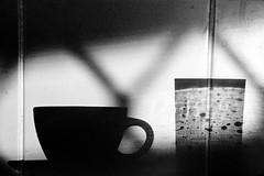 Kitchen Shadows (Erich Schieber) Tags: shadow blackandwhite australia coffeecup interior