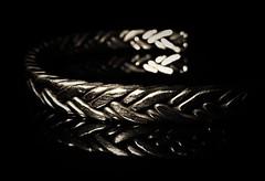 Handmade Bracelet..x (Lisa@Lethen) Tags: macromondays handmade bracelet metal stainless steel rods jewellery blacknwhite bw bokeh reflection macro hmm mm present