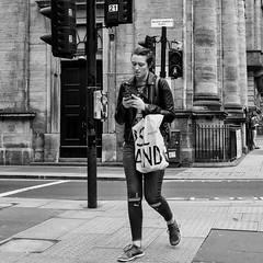Glasgow 05 (Peter.Bartlett) Tags: bag noiretblanc unitedkingdom people city olympuspenf woman walking urbanarte cellphone urban lunaphoto square girl streetphotography candid uk m43 microfourthirds mobilephone bw peterbartlett sign blackandwhite niksilverefex monochrome glasgow scotland