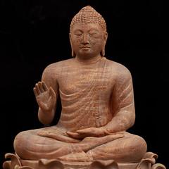 Handmade wooden Buddha sculpture (Chandana Witharanage) Tags: srilanka southasia macromondays handmade buddha handcarvedbyawellknowcraftman sizewithintherange buddhism buddhist background tabletop canoneos7d ef100mmf28lmacroisusm photographybychandanawitharanage