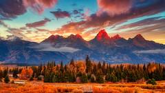 Sunrise, Grand Tetons (stewartbaird) Tags: grandteton autumn usa landscape unitedstatesofamerica sun nature nationalpark morning clouds sunrise red fall golden wyoming