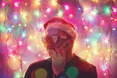 The Holidays are Calling.... (JLC Photography Spokane,WA) Tags: selfportrait weird bokeh creative christmaslights odd conceptual selfie photoshop canon lights washington holidays spokane cellphone santahat pnw 6d flipphone multicoloredlights ladygaga cigaretteglasses christmas portrait man male guy festive colorful artistic smoke samsung portraiture