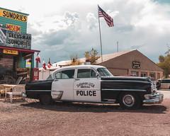 Seligman       Historic Police Car (JB_1984) Tags: seligmanhistoricsundries store car policecar americana route66 historicroute66 mainstreetofamerica motherroad seligman arizona az unitedstates usa sony rx100iii rx100m3