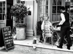 Classic Friday Film Club (garryknight) Tags: london on1photoraw iphone mono monochrome blackwhite themonoseries street candid poster filmclub customer waiter eating drinking dining alfresco