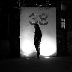between the two spots (pascalcolin1) Tags: paris13 homme man nuit night lumière light spots porte door ombres shade photoderue streetview urbanarte noiretblanc blackandwhite photopascalcolin 50mm canon50mm canon