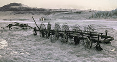 Wheels for turning (David Feuerhelm) Tags: infrared wideangle agricultural farming machine hay building mountain nikkor 1635mmf4 nikon d90 ir