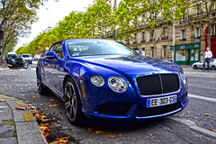 Paris, France - October 24th 2019 : Blue Bentley Continental GT Cabriolet parked on a parisian avenue. This model is one of the year 2019 for this brand.