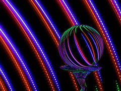 Blue & Red With a Hint of Green (Karen_Chappell) Tags: blue red green ball orb sphere round circle glass refraction lines curves curve arc led glow black light lights lightpainting longexposure stilllife abstract colour color colours colors colourful multicoloured