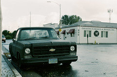 Santa Clara, California (bior) Tags: lomography metropolis film lomo lomochrome xr 100–400 lomochromemetropolisxr100–400 nikonf80 50mm santaclara california residential suburbs overcast sidewalk pickuptruck chevy chevrolet lightindustry