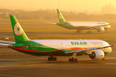 Green Sunset at Taoyuan... (Manuel Negrerie) Tags: b17885 7879 777300er boeing airplanes aircraft evergreen evaair tpe sunset sight airport moment canon photography aviation travel taiwan taoyuanairport jetliners airliners lights br spotting design logo livery colors