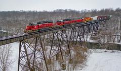 Reds on the Trestle (Wheelnrail) Tags: indiana ohio iory io lsl lima south local train trains railroad railway quincy trestle miami river valley bridge snow winter freight sd402 emd