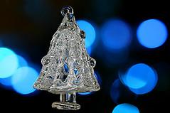 mesmerizing blues behind the tree (HansHolt) Tags: seasonsgreetings merrychristmas feliznavidad joyeuxnoël froheweihnachten vrolijkkerstfeest buonnatale feliznatal srozhdestvomkhristovym godjul glædeligjul καλάχριστούγεννα wesołychświątbożegonarodzenia uncrăciunfericit boldogkarácsonyt veselévánoce geseëndekersfees glass antique christmas tree ornament light blue bokeh macro reflection mesmerizing blues canon 300d canoneos300d canonef100mmf28macrousm