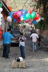 Our Lady of Guadalupe balloon seller (posterboy2007) Tags: ajijic mexico road street vendor seller balloons guadalupe fiesta
