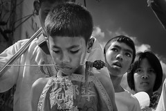 The Mood Of The 9 Emperor - Photo 32 (Mio Cade) Tags: pierce ritual religion taoist tao phuket thailand asia kid boy child medium mason young pain mood monochrome documentary reportage religious needle god
