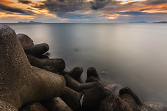 Beyond the known things... (Emykla) Tags: portici nikon campania napoli longexposure nuvole clouds mare sea rocce rocks silk silky seta isole island italy tramonto sunset d7500