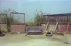ouch (Tom Kondrat) Tags: taiwan analogue film mediumformat 120 6x9 kodakportra160 expiredfilm agfabox44 sofa couch sunny abandoned lovelyday fence tyre