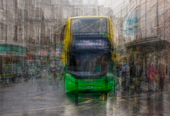The number 22 (Marion McM) Tags: red bus doubledecker intheround multipleexposures city urban citycentre busstop busshelter rain road pavements buildings dundee angus scotland canoneosm5 2019