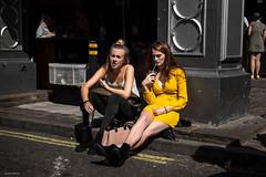 Yellow Details (Silver Machine) Tags: london streetphotography street streetportrait candid girls sitting drinking pavement sunshine yellow fujifilm fujifilmxt10 fujinonxf35mmf2rwr