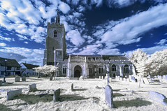 A ghostly churchyard (David Feuerhelm) Tags: infrared ir falsecolour wideangle church building tower churchyard graves gravestones sky blue trees grass boxford suffolk england sigma 1020mmf456 nikon d90 old history historic