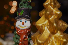 Happy warm snowman (7 Blue Nights) Tags: snowman christmasdecoration decoration ornament christmas macro festive happy happiness smile bokeh christmastree orange golden sony rx10 candle cute itsbeginningtolookalotlikechristmas