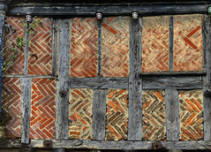 Medieval half-timbered wall with herringbone brick infill - Norwich, Norfolk, England. (edk7) Tags: nikond300 edk7 2010 england norfolk norwich 125127kingstreet city cityscape urban construction weatheredwood architecture building oldstructure brick timber halftimberedwallwithherringbonebrickinfill boardedupmedievalfirstfloor texture pattern
