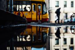 Eyes forward (ewitsoe) Tags: autumn december nikon refflection street travel erikwitsoe poland urban warsaw bokeh walk puddle tram transit sunny chilly man silhouette bokehpeople reflection reflecting mirror water