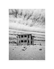 The legend of Hill House (G. Postlethwaite esq.) Tags: bw kolmanskop namibia unlimitedphotos blackandwhite building clouds ghosttown house monochrome photoborder sky southernafrica