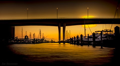 Sunset at the Harbor (JDS Fine Art Photography) Tags: landscape harbor ocean sea boats sunset beauty golden illumination inspirational bridge