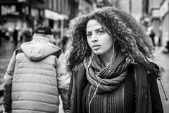 Wired for Sound (Leanne Boulton) Tags: urban street candid portrait portraiture streetphotography candidstreetphotography candidportrait streetportrait streetlife eyecontact candideyecontact woman female girl pretty face eyes expression mood emotion feeling confidence earbuds music hair style hairstyle fashion scarf cold winter tone texture detail depthoffield bokeh naturallight outdoor light shade city scene human life living humanity society culture lifestyle people leanneboulton canon canon5dmkiii 70mm ef2470mmf28liiusm black white blackwhite bw mono blackandwhite monochrome glasgow scotland uk
