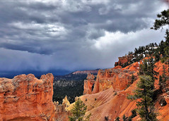 CLOUDY HORIZON (Rob Patzke) Tags: clouds red rock tree canyon bryce snow storm nature landscape park iphone utah